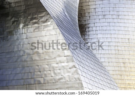 Wall titanium forms, detail of a building decorated with titanium metal coating, protection and decoration - stock photo
