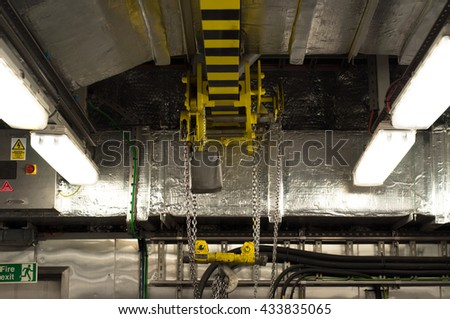 wall traveling jib crane inside a mechanical workshop