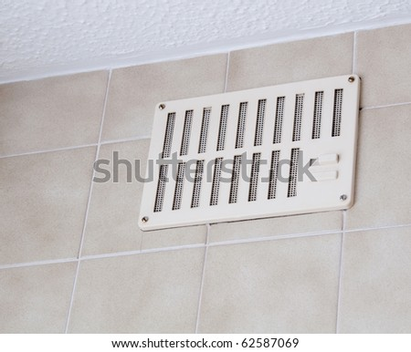 Wall vent in a kitchen - stock photo