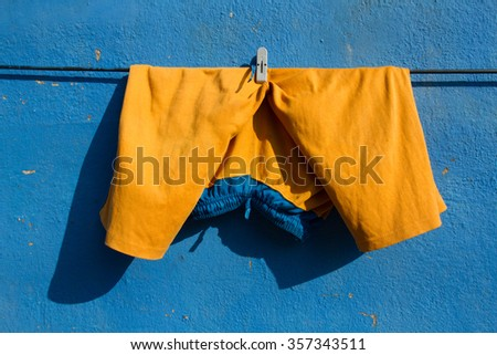 Wall. Walls. Walls and paints. Yellow shorts. Blue wall. Simple Life. Indian style. Backgrounds. Textures. Smell.