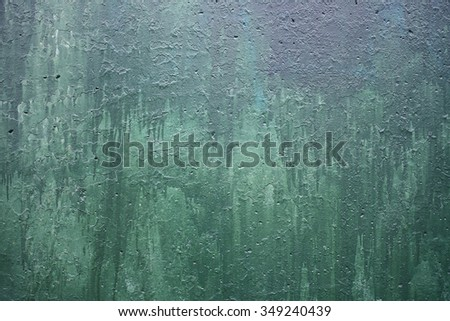 wall with a faded green paint color - stock photo