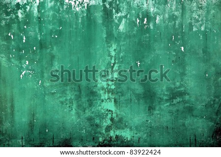 wall with a faded green paint color and mossy - stock photo