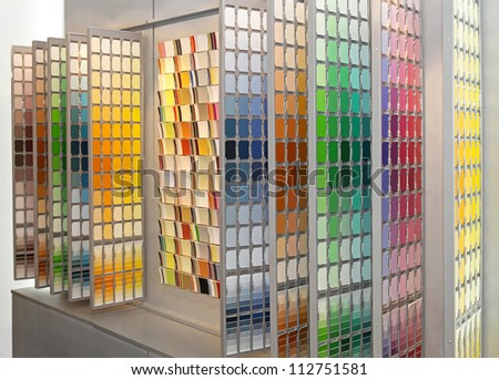 Wall with big palette of colour swatch cards - stock photo