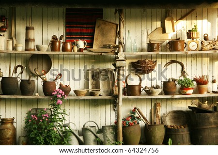 Wall with different old tools used on Polish villages - stock photo