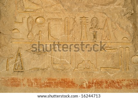 Wall with egyptian hieroglyphic carving in Deir El-Bahri Temple, Luxor, Egypt
