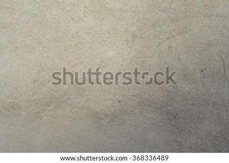 Wall with gray rough concrete plaster on the street - stock photo
