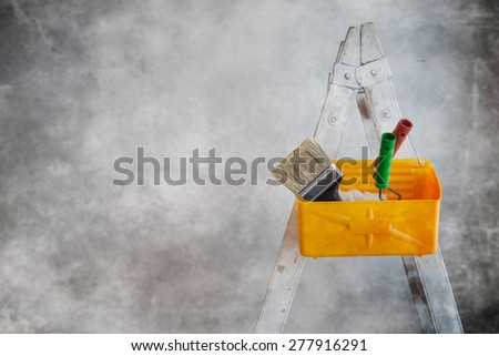 Wall with paint cans and ladder during room renovation - stock photo