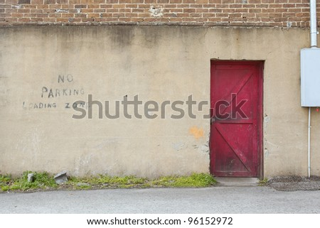 wall with red door background - stock photo