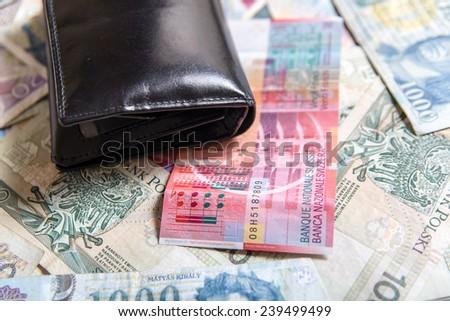 Wallet and international money - stock photo