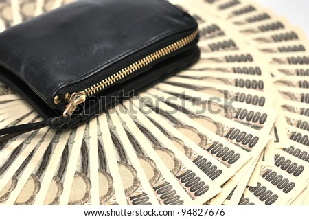 wallet and Japanese money - stock photo