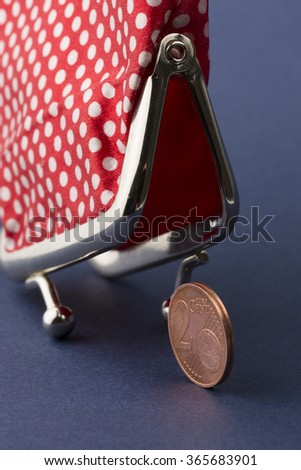 Wallet and last two euro cent on blue background - stock photo