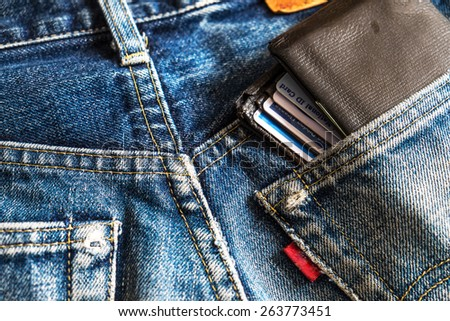 Wallet brown in jeans pocket - stock photo