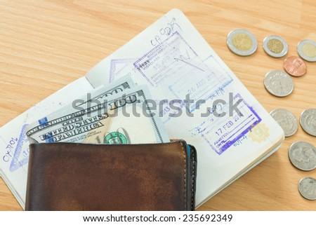 wallet cash hundred dollars passport - stock photo