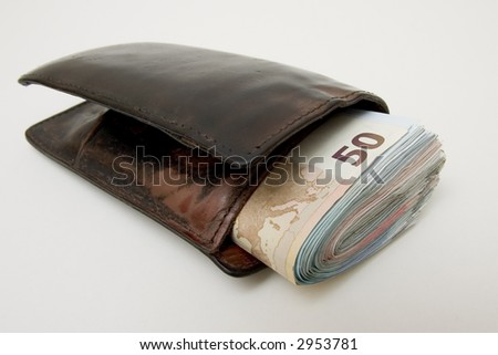 wallet full of cash ready for some investment