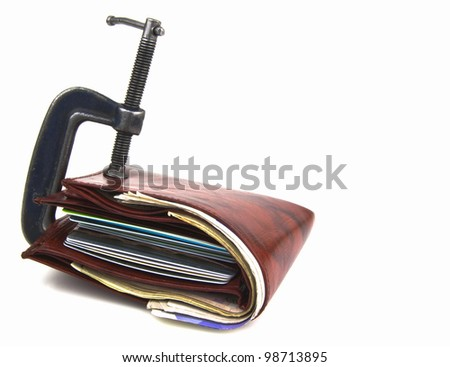 wallet full of money, but restricted with clamp - stock photo