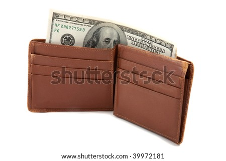 Wallet full of money, standing up, with cash sticking out - stock photo