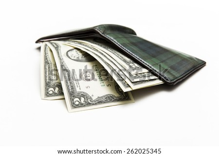 Wallet full of Two dollar bank note on background - stock photo