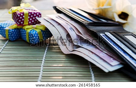 wallet money with gif box - stock photo