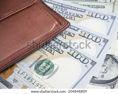 Wallet on Dollar Banknotes - stock photo