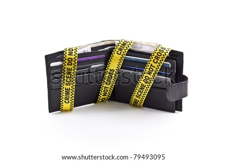 Wallet open with crime scene tape around it, isolated on a white background - stock photo
