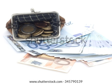 Wallet with euro coins and banknotes on a white background