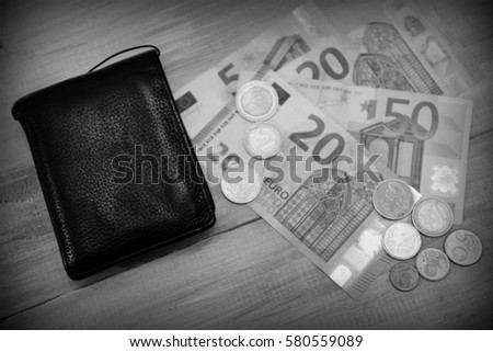 wallet with money on table, black and white
