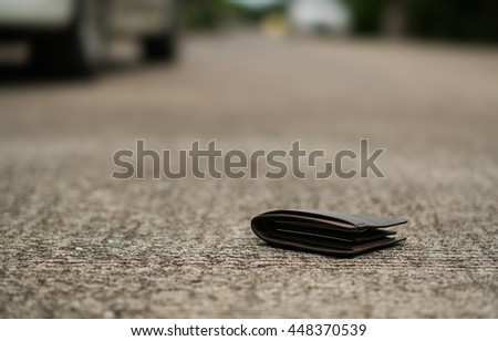 wallet with money on the street, lost money concept, copy space on Left side - stock photo
