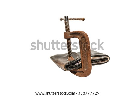 Wallet with money pushed by a clamp on white background - stock photo