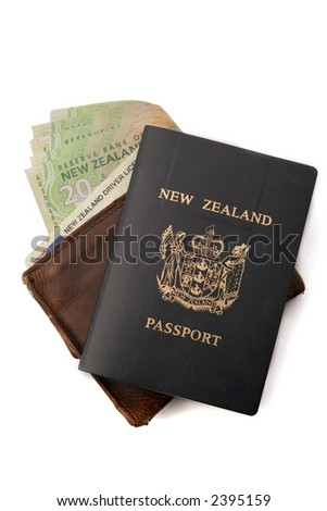 Wallet, with New Zealand Money, and drivers license showing, passport on top. - stock photo