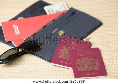 Wallet with passports, tickets and travellers checks