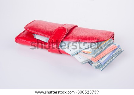 wallet. woman wallet with money on background