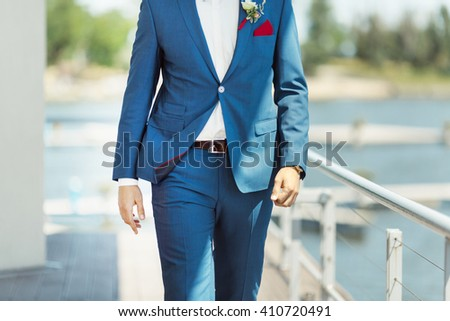 Wallking groom. Details of the suite without face - stock photo