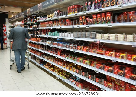 WALLONIA, BELGIUM - OCTOBER 17: Shelves with a variety of chocolate products in a Carrefour Hypermarket on October 17, 2014 in Wavre, Belgium - stock photo
