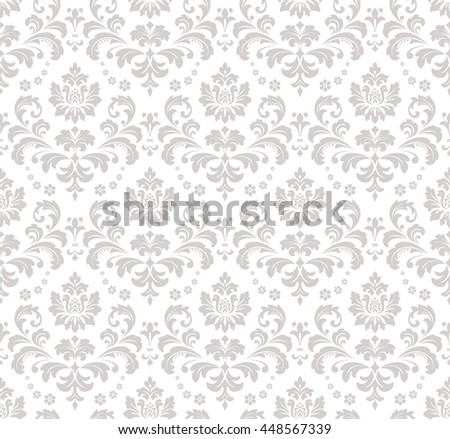 Wallpaper in the style of Baroque, damask. A seamless  background. Gray and white ornament. Stylish graphic pattern.