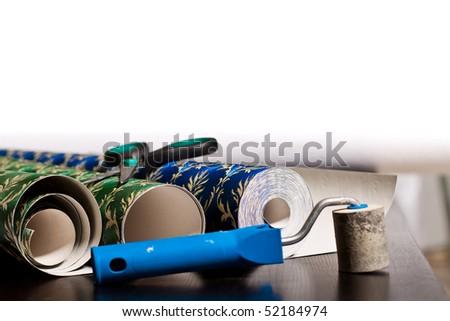 Wallpaper rolls. Selective focus - stock photo