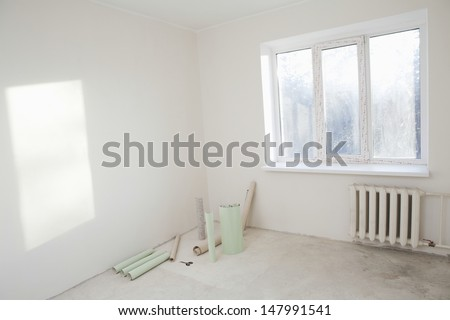 Wallpapers in the corner of new apartment - stock photo