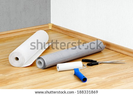 Wallpapers,roller and scissors lying on the floor. - stock photo