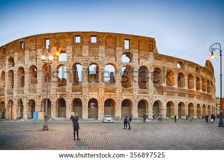 walls and arches of Roman amphitheater, the Coliseum in Rome, Italy - stock photo