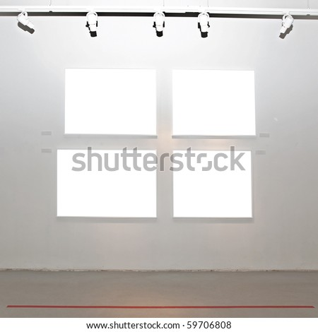 Walls in museum with empty frames - stock photo