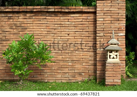 Walls made of brown brick and stone lamps in the park. - stock photo
