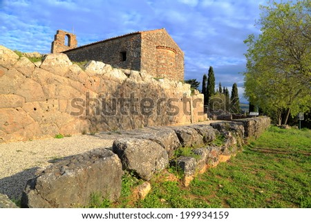 Walls of Hades sanctuary and a Byzantine church built on top, Greece - stock photo