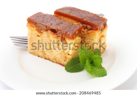 walnut and salted caramel cake isolated on white - stock photo