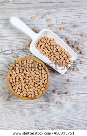 Walnut chickpeas in a bamboo bowl with white juice - stock photo
