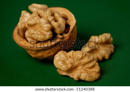 Walnut closeup isolated on green background food still life - stock photo