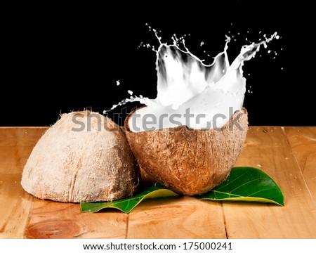 walnut coconut milk on wood - stock photo