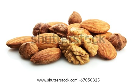 Walnut, filbert and almonds on a white background