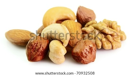 Walnut, filbert, cashew and almonds on a white background - stock photo