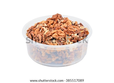 Walnut in plastic bowl, isolated on white background