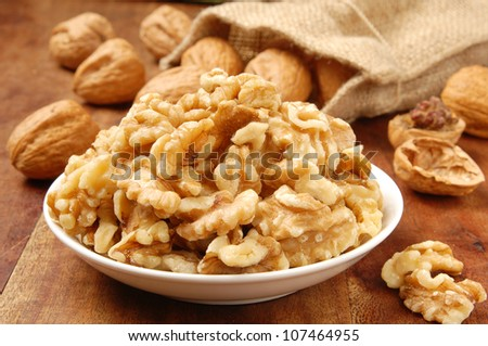 Walnut kernel  in a white bowl - stock photo
