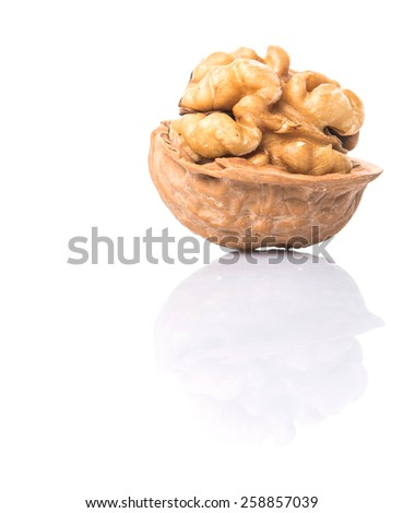 Walnut nuts over white background - stock photo